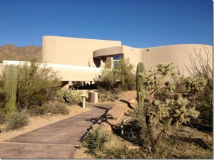 adobe building with desert landscaping